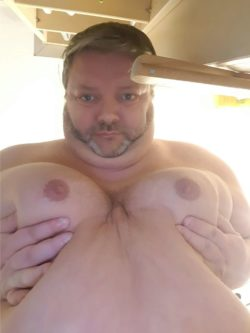 Look at the titties on this fat loser