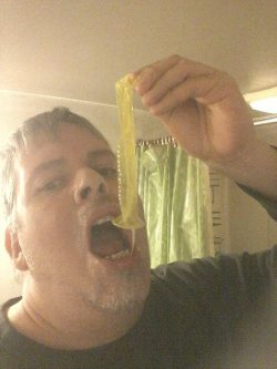 Look at this nasty faggot. Dumping cum from a used condom I found.