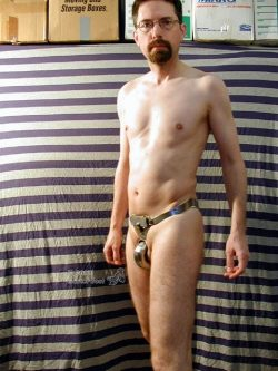 proud to be naked and locked in a heavy steel belt