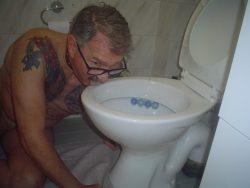 FAGGOT CLEANING TOILET